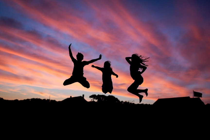 Image of happy people jumping during their healthy lifestyle reboot